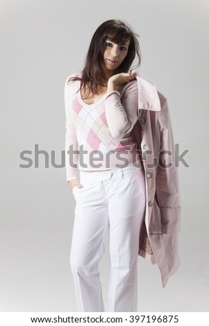 young woman in a coat on white