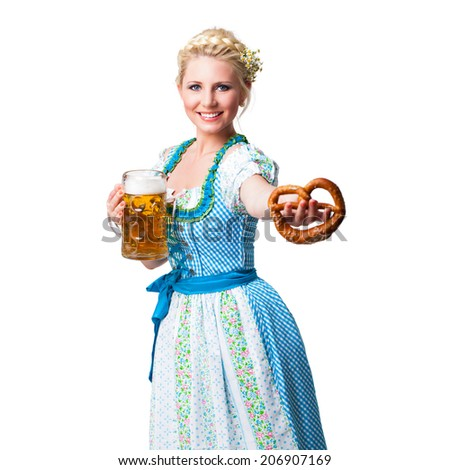 young woman in a dirndl with a beer and a pretzel  - stock photo