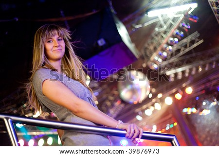 young woman in a discotheque - stock photo