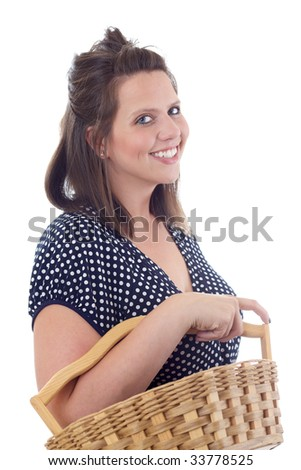 Young woman in a dress carrying a wicker basket; isolated on a white background. - stock photo