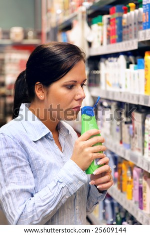 Young woman in a drugstore at shopping - stock photo