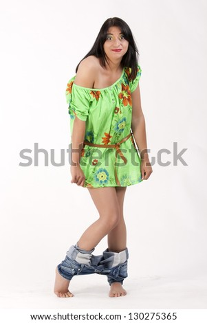 Young woman in a floral tunic with a lowered jeans / Ups - stock photo
