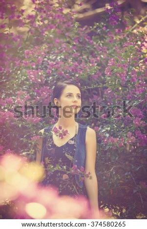 Young woman in a flower garden