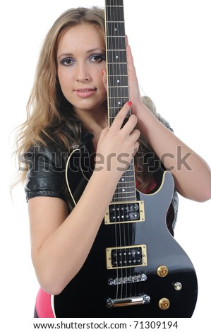 young woman in a full-length with a black guitar in his hand. Isolated on white background - stock photo