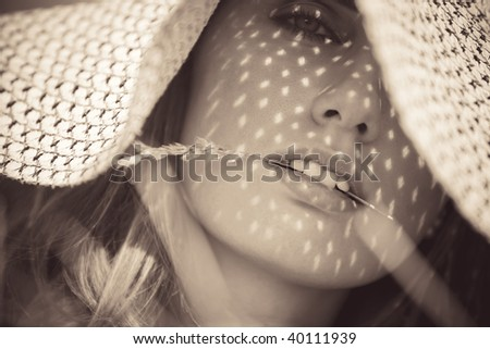 Young woman in a hat portrait. Sepia colors. - stock photo