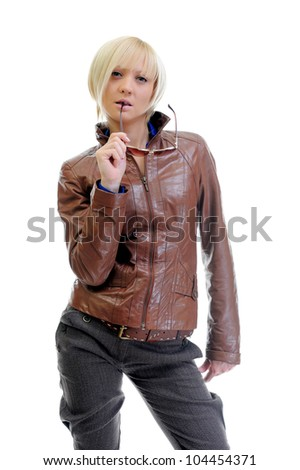 young woman in a leather jacket. Isolated on a white background - stock photo