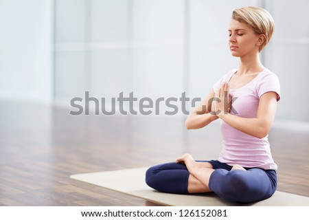 Young woman in a lotus position - stock photo