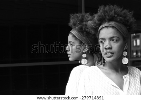 young woman in a mirror - black and white photography - stock photo