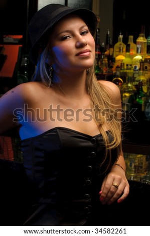 Young woman in a nightclub bar, posing very sexy. - stock photo