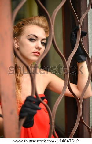 young woman in a prison cell - stock photo