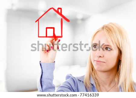 Young woman in a real estate concept - stock photo
