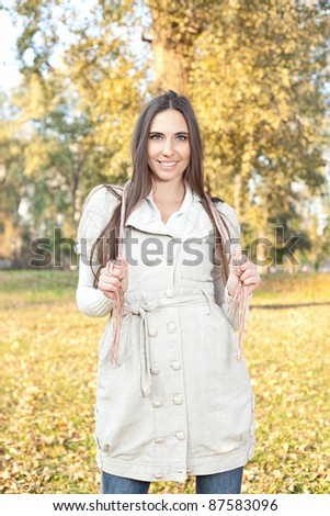 Young woman in a romantic autumn park