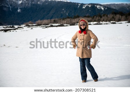 Young woman in a snowy mountain - stock photo