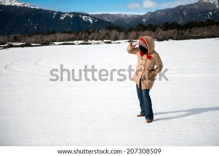 Young woman in a snowy park - stock photo