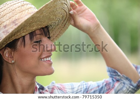Young woman in a straw hat - stock photo