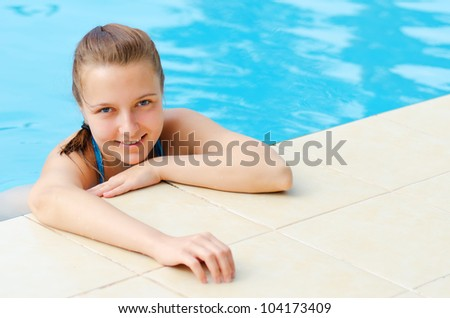 Young woman in a swimming pool.