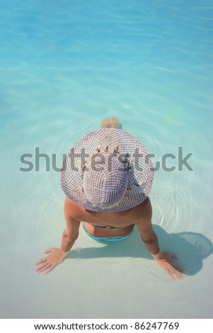 Young woman in a swimming pool - stock photo