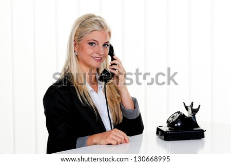 young woman in a telephone call in the office.