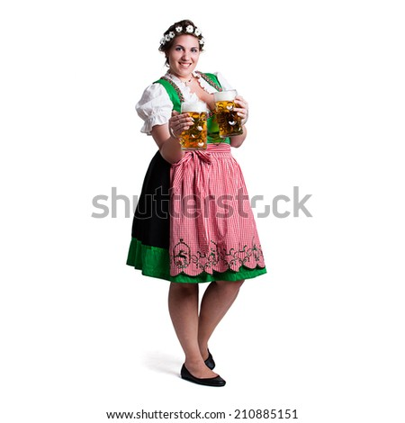 young woman in a traditional dirndl with two beer - stock photo