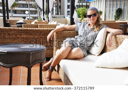 Young woman in a trendy lounge - stock photo