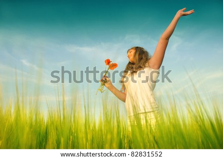 Young woman in a wheat - stock photo