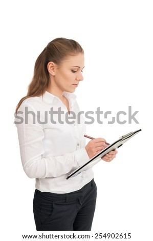 Young woman in a white shirt holds office papers
