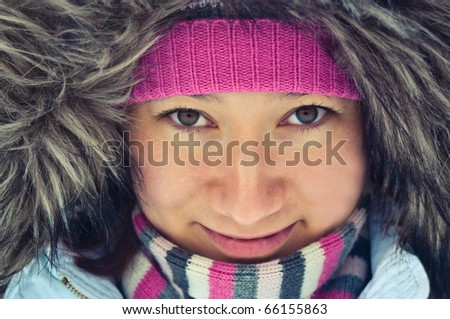young woman in a winter coat - stock photo