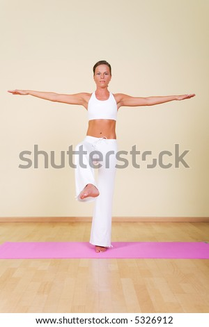 Young woman in a yoga position - stock photo