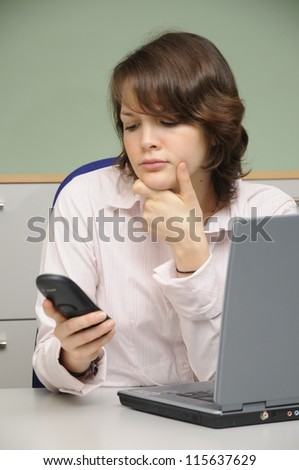 Young woman in an office - stock photo