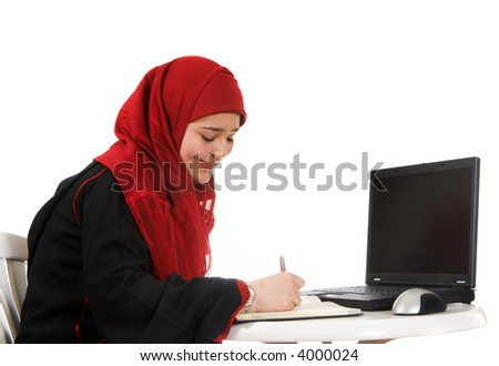 Young woman in an office, wearing a veil
