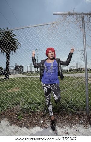 Young woman in an urban setting - stock photo