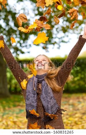 Young woman in autumn having fun - stock photo