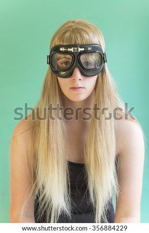 Young woman in aviator goggles - stock photo