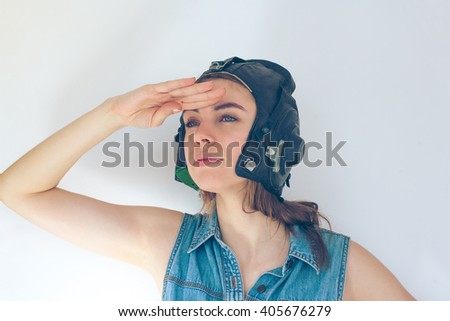 Young woman in aviator helmet looking into the distance - stock photo