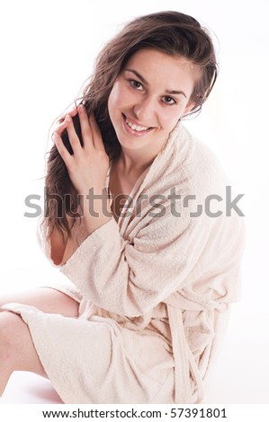 Young woman in bathrobe after washing her hair - stock photo