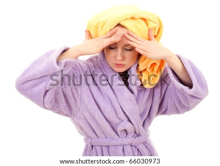 young woman in bathrobe and yellow towel on head with pain -  headache