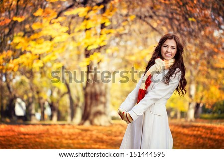 Young woman in beautiful autumn park, concept autumn - stock photo