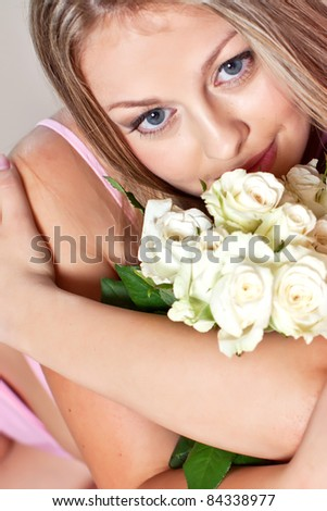 Young woman in bed. - stock photo