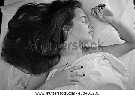 young woman in bed, pillow, blanket, sleeping - stock photo