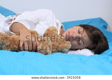 young woman in bedroom - rest - stock photo