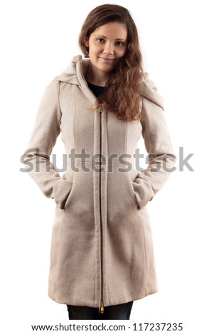 Young Woman In Beige Coat - stock photo