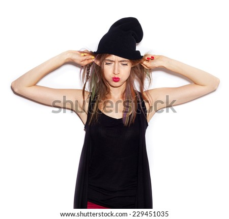 young woman in black beanie having fun. White background, not isolated - stock photo