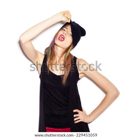 young woman in black beanie . White background, not isolated - stock photo