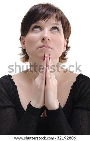 young woman in black dress praying isolated on white