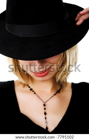 young woman in black hat on black