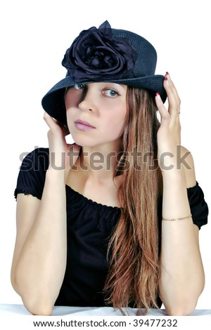young woman in black hat on white background