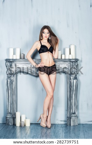 Young woman in black lingerie - stock photo