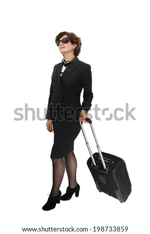 Young woman in black suit with travel suitcase isolated on white background