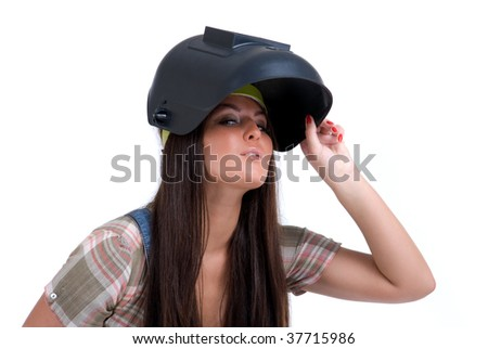 Young woman in black welder`s mask