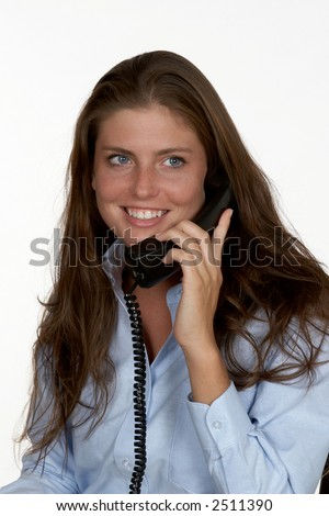 Young Woman in Blue Blouse Talking Phone - stock photo